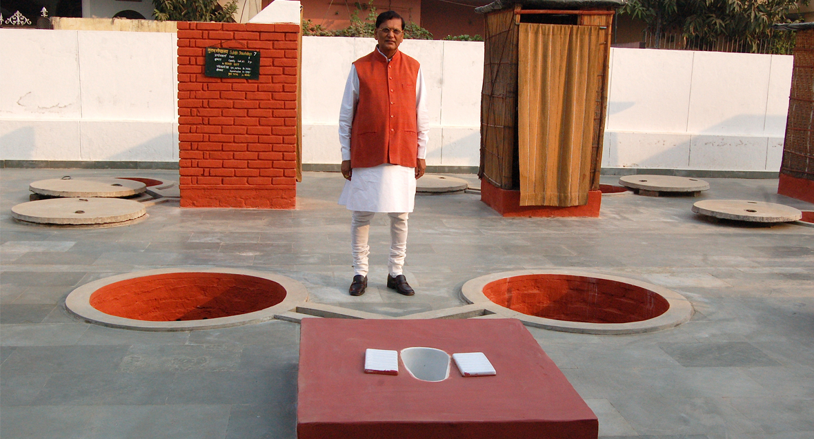 Bindeshwar Pathak with his-two-pit Indian latrine model